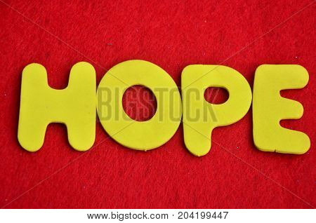WORD HOPE ON A  ABSTRACT RED BACKGROUND