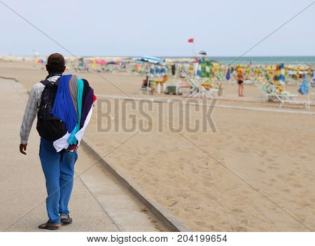 Poor Walking Salesman Along The Beach