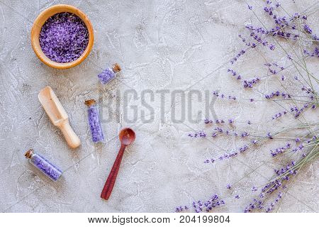 bath salt in herbal cosmetic set with lavender on stone desk background top view space for text