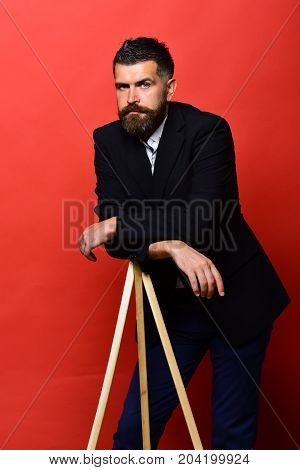 Man With Beard Wearing Classic Suit. Macho On Photo Tripod