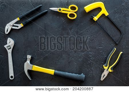 building, painting and repair tools frame for house constructor work place set on dark background top view space for text