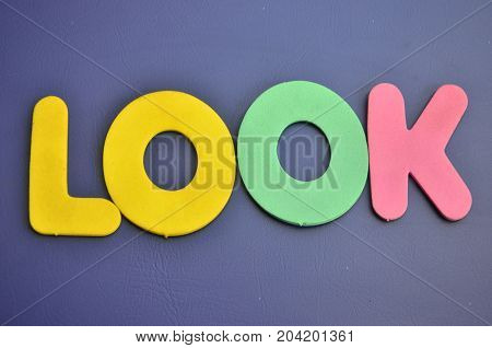 WORD LOOK ON A  ABSTRACT COLORFUL BACKGROUND