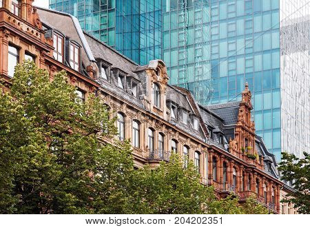 Old historical buildings in the background of modern office building in Frankfurt Germany
