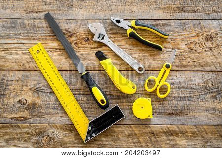 constructor desk with set of building implements on wooden desk background top view