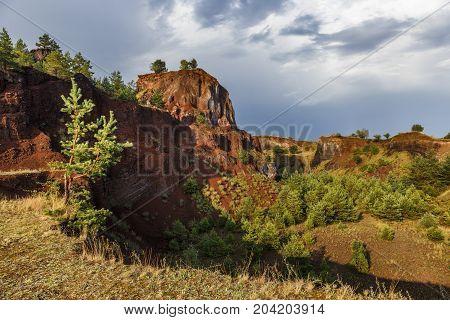 Abandoned career of red scorea rocks, alike grand canyon