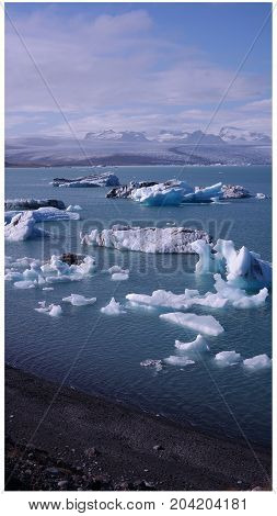 Jökulsárlón, a large glacial lake with big pieces of ice, Breiðamerkurjökull glacier in the background, Iceland