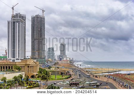 Colombo, Sri Lanka - August 14, 2017: View of Fort skyline under stormy sky. Fort is the central business and financial district of Colombo. It is also home of government departments and offices