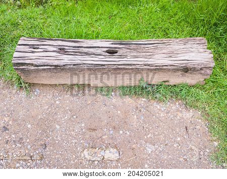 Old wooden sleeper near the platform to use as the bench for the passenger in the rural stationThailand.