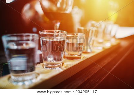 Close Up On Vodka Shots And Other Alcohols In A Row