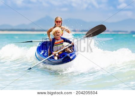 Kids Kayaking In Ocean. Children In Kayak In Tropical Sea