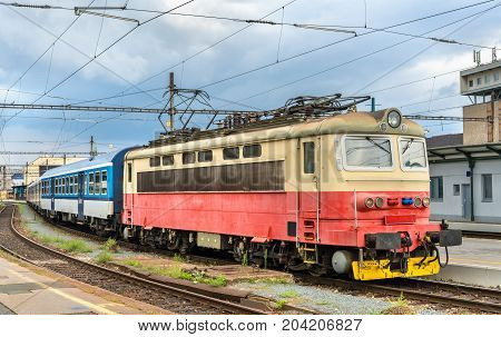 Old electric locomotive with a passenger train at Brno Central Station, Czech Republic