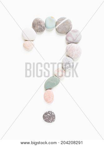 Sea pebbles, sea stones question mark. Sea pebbles background.