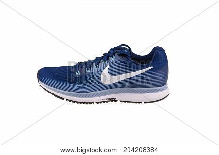 BURGAS, BULGARIA - SEPTEMBER 7, 2017: Nike Air Zoom Pegasus 34 Women's Running Shoes in blue isolated on white background. Nike is a global sports clothes and running shoes retailer.