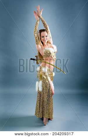 Fashion girl in belly dance dress exotic lifestyle