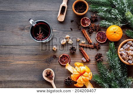 Ingredients of hot mulled wine or grog set with spices and citrus for winter evening. Christmas and new year eve. Wooden background top view. Mockup