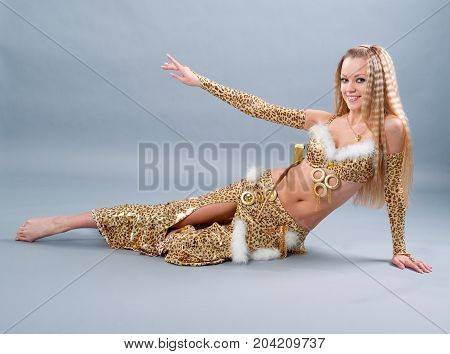 Fashion girl in belly dance dress studio