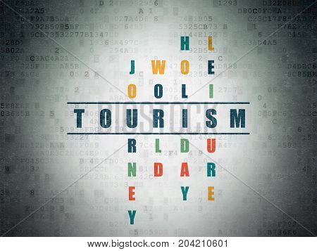 Tourism concept: Painted blue word Tourism in solving Crossword Puzzle on Digital Data Paper background