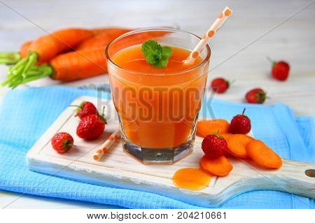carrot-strawberry smoothie with mint in a glass