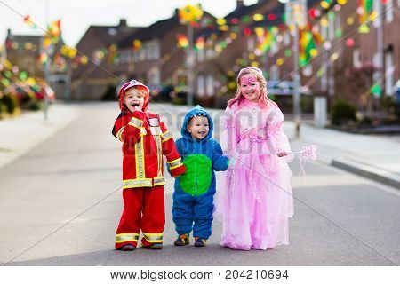 Kids On Halloween Trick Or Treat.