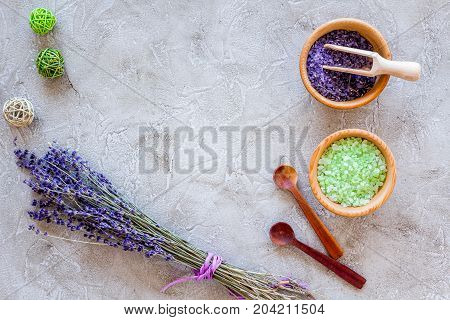 organic cosmetic set with lavender herbs and sea salt in bowl on stone table background flat lay mockup