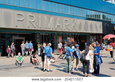 BERLIN, GERMANY - AUGUST 08, 2017: Tourists and residents in front of a branch of the fashion discounter Primark at Alexanderplatz in Berlin