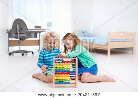 Kids Playing With Wooden Abacus. Educational Toy.