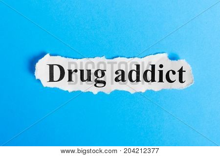 Drug addict text on paper. Word Drug addict on a piece of paper. Concept Image.