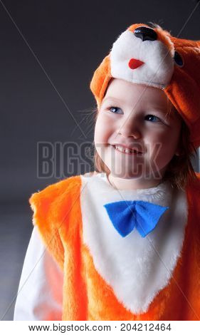 Little baby girl dressed in a fox suit .Closeup