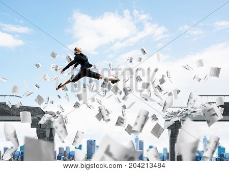 Business woman jumping over gap with flying paper documents in concrete bridge as symbol of overcoming challenges. Cloudly skyscape on background. 3D rendering.