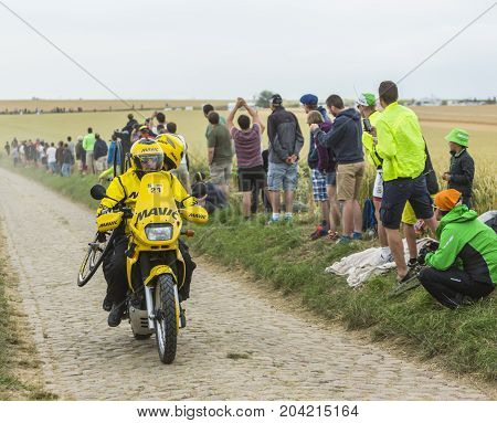 QuievyFrance - July 07 2015: Image of the technical yellow bike of Mavic driving on a cobblestoned road during the stage 4 of Le Tour de France 2015 in Quievy France on 07 July2015.