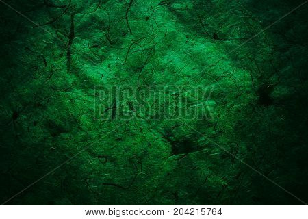 Green vintage background. Rough dark green texture and background for designers. Close up view of abstract green texture made with recycle paper. Plant fiber background. Vintage green paper background.