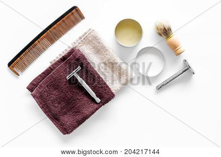 Workplace in barbershop with tools. Razor, shaving brush, comb on white background top view.