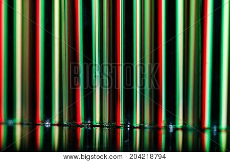 Christmas Abstract: Vertical Streaks of Red and Green Light Forming a Holiday Background