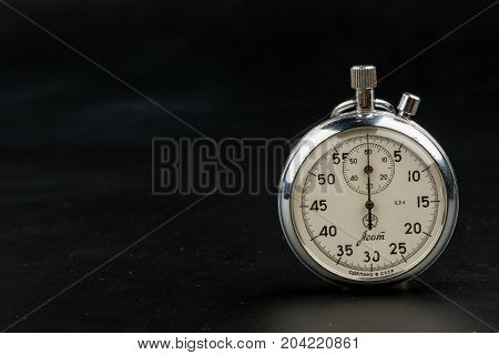 stopwatch on a black background, result, seconds, arrow, minute