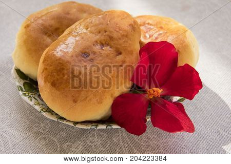 Fresh Only Baked Fluffy Hot Pies With Orange Crust Oiled Lie On A Thin Porcelain Saucer With A Red F