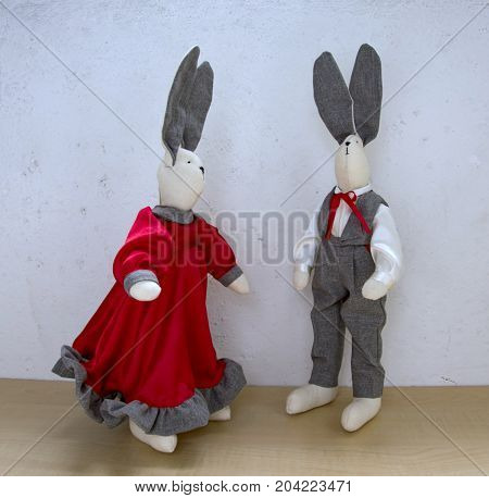 Cute Rabbits, A Couple For A Walk In Front Of A Light Wall, A Girl In A Red Satin Dress And A Cheval