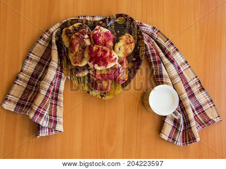 Hot Pie With Berries, Fried In Oil, Lined In A Dish, A Mug Of Cold Milk, On A Napkin