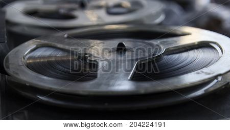 Vintage tape recorder is playing music close up
