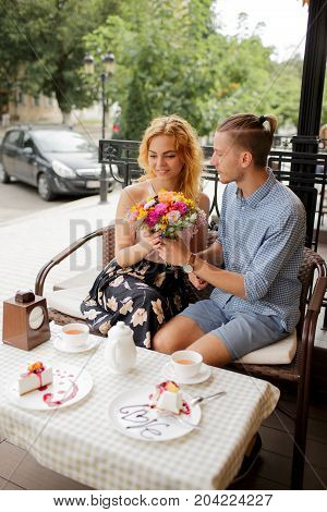 Beautiful rest together in a cafe. St. Valentine's Day.