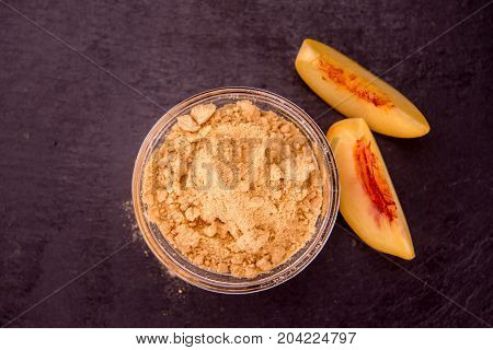 Portion Of Ground Peaches On A Slate Slab