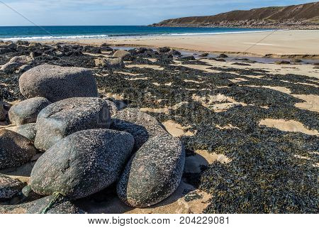 Slaggan Bay boulders, beach, sand and bay.