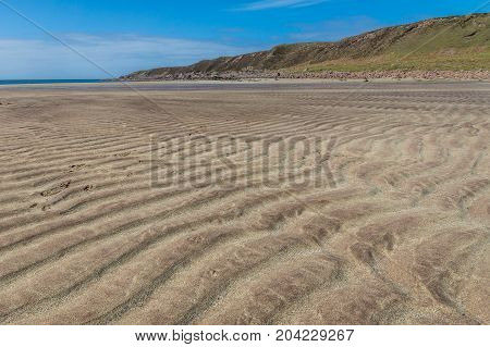 Ripples left by the tide in the sand at Slaggan Bay.