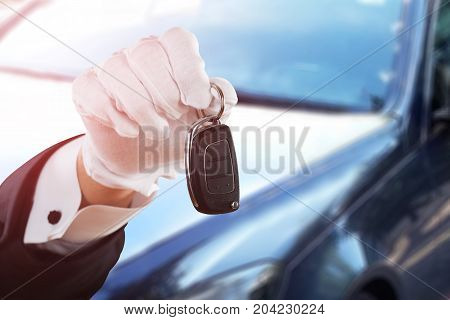 Close-up Of Valet Boy Hand In White Glove Holding Car Key