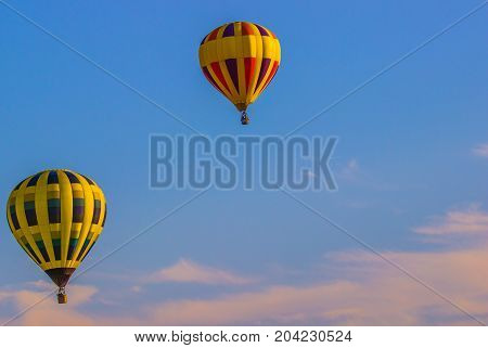 Two Hot Air Balloons In Early Morning