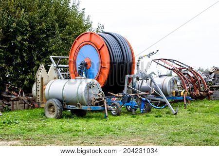 Trailers With Fertilizer Tanks And A Drum With A Watering Hose.