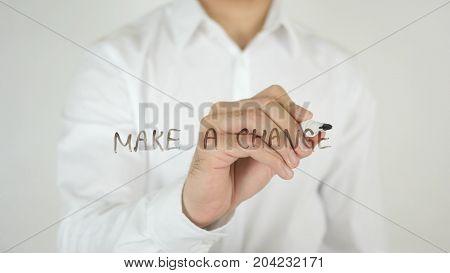 Make A Change, Written On Glass By Man In Studio