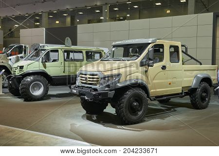 MOSCOW, SEP, 5, 2017: View on special custom off-road mud trucks GAZ for hard to reach areas. Off road cargo trucks for civil military transportation. Commercial Transport Exhibition ComTrans-2017