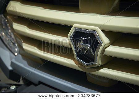 MOSCOW, SEP, 5, 2017: View on off-road mud trucks GAZ deer logo on car radiator. Car symbol logo. Commercial Transport Exhibition ComTrans-2017. Deer logo off road car