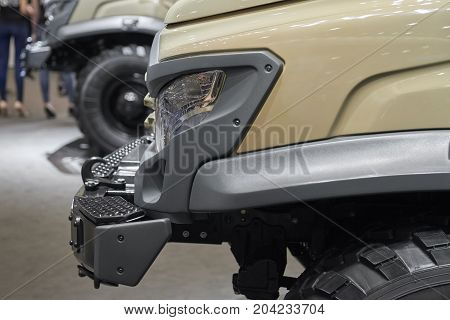 MOSCOW, SEP, 5, 2017: Close up view on russian off road car GAZ for for hard to reach areas and hunting. Car lights. Commercial Transport Exhibition ComTrans-2017. Off-road car close up. Military jeep