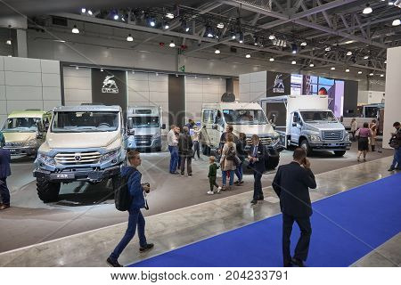 MOSCOW, SEP, 5, 2017: View on GAZ stand with cars vehicles and mud trucks for hard to reach areas. Off road trucks for civil cargo transportation. Commercial Transport Exhibition ComTrans-2017 Trucks